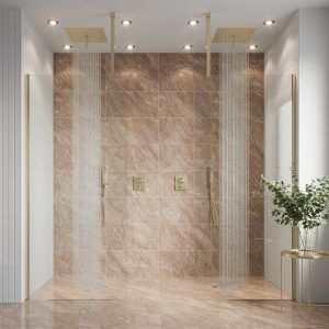 This is a walk-in shower / wetroom with a double shower, the shower is a  brushed brass finish, against a pink styled marble backdrop. This would be a great focal point to show off on your spa day.