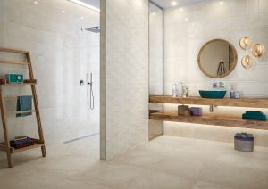 This is a modern open planned bathroom with a mirror and hanging vanity unit. There is also a indie styled towel rack. There is a minimalistic feel of the room, which reminds the viewer of a elegant spa day.