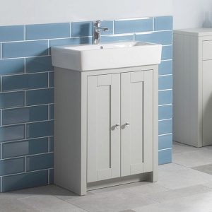 This 2 door vanity unit is fixed to the wall, it's in a beautiful shaker inspired style with a grey paint job and basin on top.