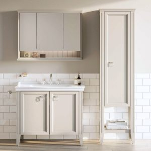 This VitrA valarte vanity unit is sat in combination with the Valarte Mirror and tower Cabinet, against a white tiled wall.