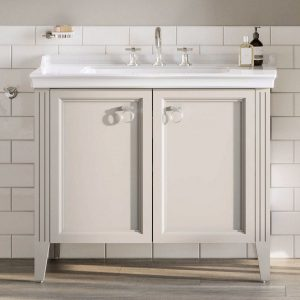 This beautiful VitrA vanity Unit is cream in colour and is freestanding against a tiled background.