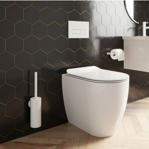This is a matching bundle of Crosswater Matt White Accessories around a toilet. There is a white toilet brush, toilet roll harder and flush plates. Nothing says spa day like a matching set of accessories!